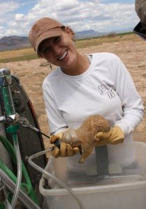 Michelle happily buries a prairie dog's head in the hand-crafted anesthetizer mask.