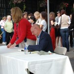 Michael Pollen signing copies of his books