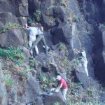 Lichenologists taking samples from rocks on the side of Bridalveil Falls