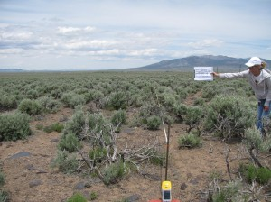 That's me holding the sign for our 100ft intersection of Sagebrush habitat!