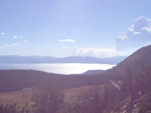 A plume of smoke rises more than a mile into the sky across Lake Tahoe.