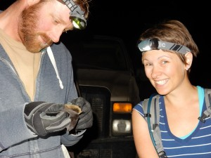 Sporting the headlamp and taking a moment to cheese for the camera while helping assess a bat.