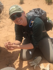 I am holding my first Side-Blotch lizard that was caught in one of the traps. Photo credits: M. McClure