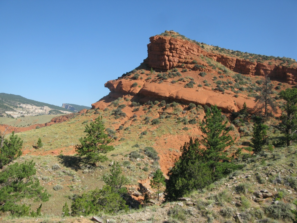 This place was the Hat Ranch Allotment! I believe we are looking at the Spearfish Formation (red sandstone). Also, this area had the Sundance Formation, which was a high yield fossil site!